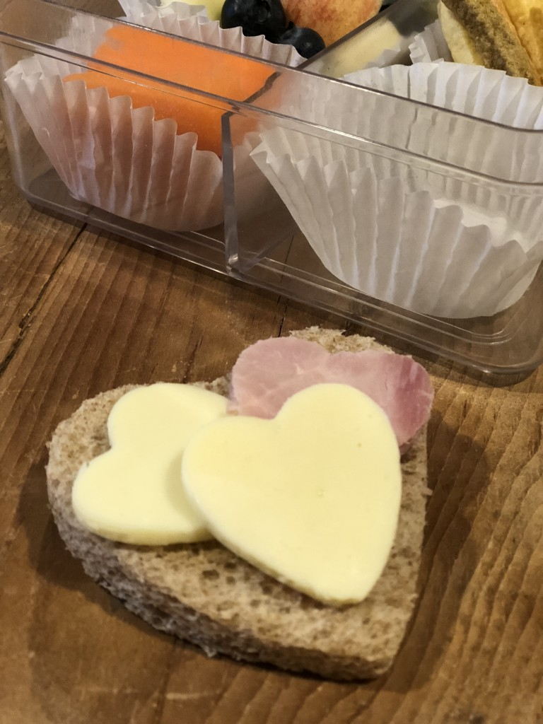 Lunchbox Refresh with My Hannaford Rewards - veggie sticks, apples, carrot sticks, heart cut out sandwich, heart cut out apples, blueberries, mini water bottle, lunchbox napkin note - From the Family With Love